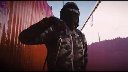The rap lyrics in the music video appear to glorify gang and knife violence