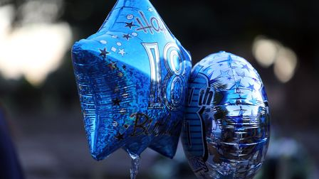 Champion's family and friends laid balloons and flowers at his grave on what would have been his 18t