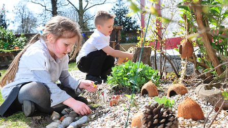 Youngsters from Somerleyton primary school enjoy the newly landscaped school garden. Corey and Alici