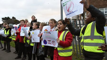 Pupils at the Oasis Academy Pinewood protesting about parents parking on the zig-zag yellow lines ou
