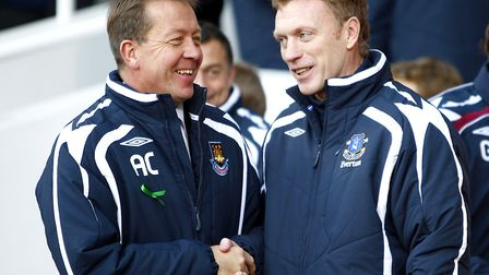 Everton manager David Moyes (r) and West Ham United manager Alan Curbishley (l) shake hands prior to