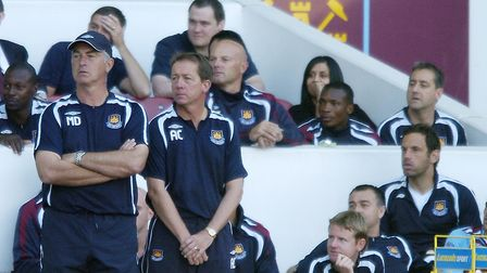 Alan Curbishley looks on from the touchline during his time in charge of West Ham