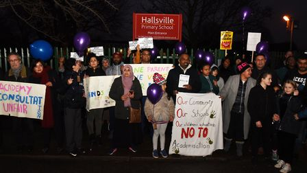 Parents and children demonstrating outside Hallsville Primary School over plans to turn the school i