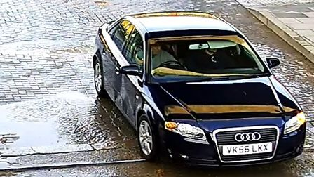 CCTV still of the blue Audi with registration VK56 LKX,which entered the site and later fled the sce
