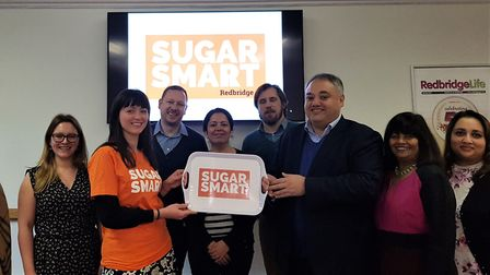 The Sugar Smart tray being handed over to Cllr Mark Santos from Sustain's Vera Zakharov , at the tow