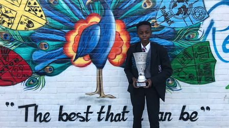 Prince Sikiru with his Player of the Tournament trophy. Photo: West Hatch High School