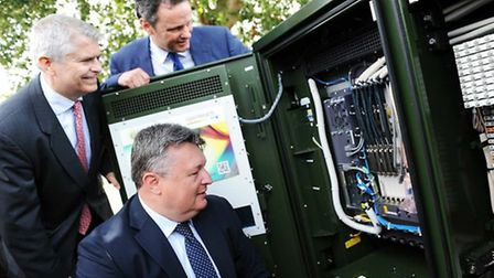 Mark Bee, foreground with Bill Murphy from BT and Waveney MP Peter Aldous at one of the upgraded bro