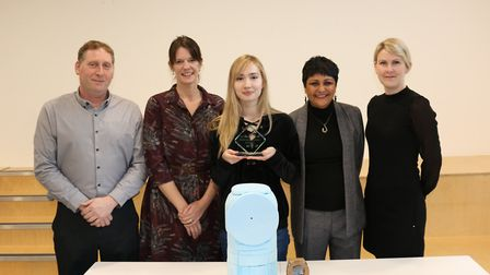 Laura-Monica Carusoto with the competition's judges and her beach bin design Picture: UEL