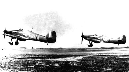 Two RAF Hawker Hurricane MK1 fighters from RAF 79 Squadron taking off from RAF Hawkinge, Kent during