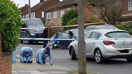 Police in Wych Elm Road, Hornchurch, where a man was shot in the early hours of New Year's Day.