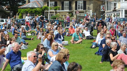 Southwold Arts Festival 2014: Street Festival.Crowds of people watching Aerialism perform on South G