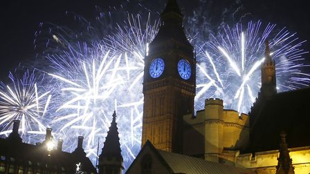 Fireworks explode over the River Thames and the Palace of Westminster's Elizabeth Tower, known as Bi