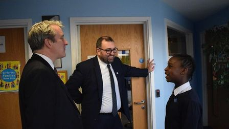 Damian Hinds with executive headteacher Paul Harris and Year 6 pupil Aisha Imam Picture: Curwen Prim