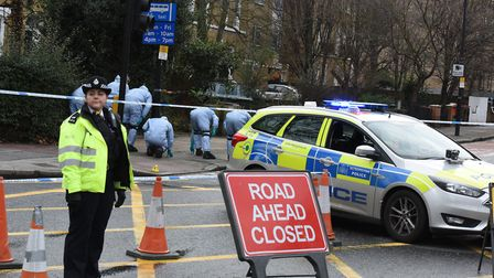 Police and forensic teams at the scene of the shooting on Romford Road in Stratford