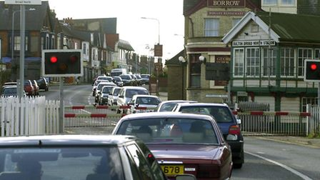 Traffic waiting at the Oulton Broad North level crossing.