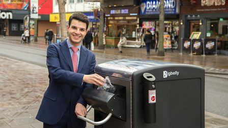Cabinet member for environment Councillor Osman Dervish with a Big Belly bin. Picture: Havering Coun