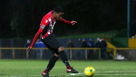 Theo Fairweather-Johnson of Hornchurch scores the fourth goal for his team to complete his hat-trick