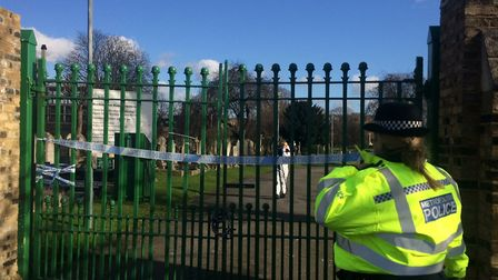 Forensic officer at the scene of an investigation in Ilford cemetry to locate missing man Seyed Khan