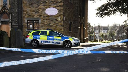 Police seal off the Buckingham Road cemetery in the search for Seyed Khan