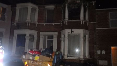 A woman had to be treated for smoke inhalation after a flat fire in Ilford last night.