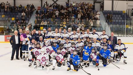 Everyone Active Raiders players and staff with youngsters on the Sapphire Ice & Leisure Centre rink