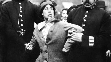 Police officers arrest a suffragette. Picture: PA