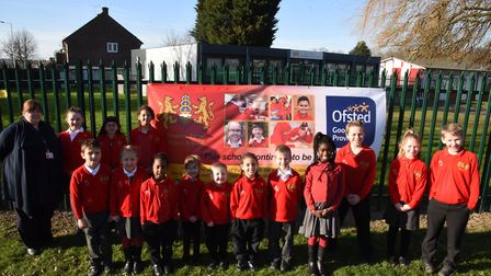 Pupils at Drapers Pyrgo Priory School celebrating the latest Ofsted result with teacher Miss Caws