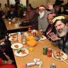 People enjoing the Christmas party put on by the Ilford Single Homeless Project
