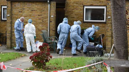 Police and forensic officers at the scene of a murder on Hood Road in Rainham