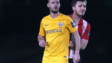 Martin Tuohy (front) and Hornchurch defender Kenzer Lee (Pic: Gavin Ellis/TGS Photo)