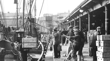 Boxed herring are seen being landed at the Waveney Dock.