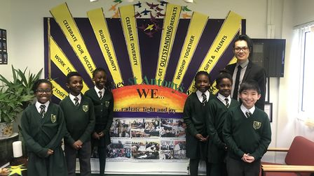 Music teacher Nathan Chan with pupils from St Antony's Catholic Primary School Picture: Save the Chi