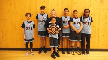 Goodmayes Primary School pupils celebrate their basketball success with coach Nicky Skinner