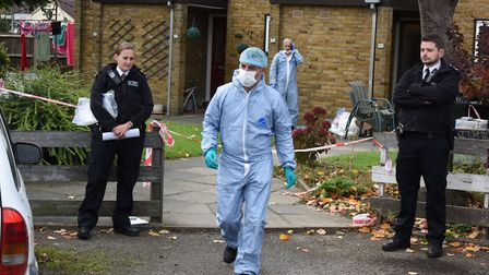 Police and forensic officers outside Rodney Parlour's flat in Hood Road, Rainham, in October last ye