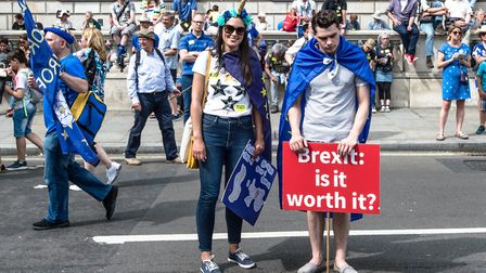 Signs are held up during a demonstration against Brexit on June 23, 2018 in London, the United Kingd