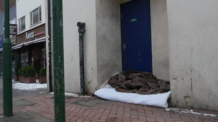 A person sleeps rough in freezing temperatures on Clements Road. Photo: Aaron Walawalkar