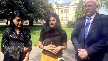 One of two acid attack victims Resham Khan (centre) with her mother Yasmin Khan and DC Paul Newton o