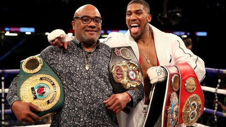 Anthony Joshua celebrates with his father Robert Joshua after victory over Joseph Parker in their WB