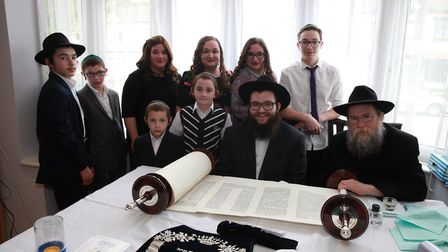 Mrs Bracha Muller and family overseeing the final letters being written in memory of her husband Rab