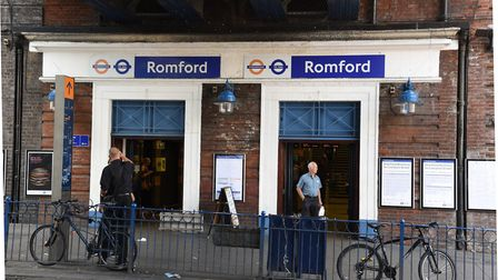 Two teenagers were arrested for carrying large knives and cannabis outside of Romford train station.