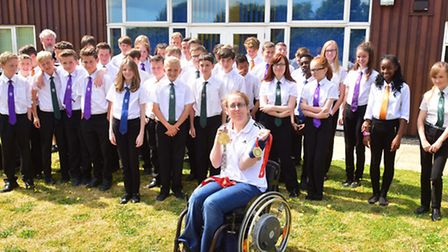 Athlete Fran Williamson with youngsters at Ormiston Denes Academy.
