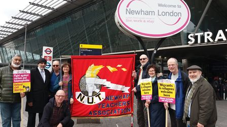 Newham Stand Up To Racism campaigners at Stratford station before joining an anti-racism day march l