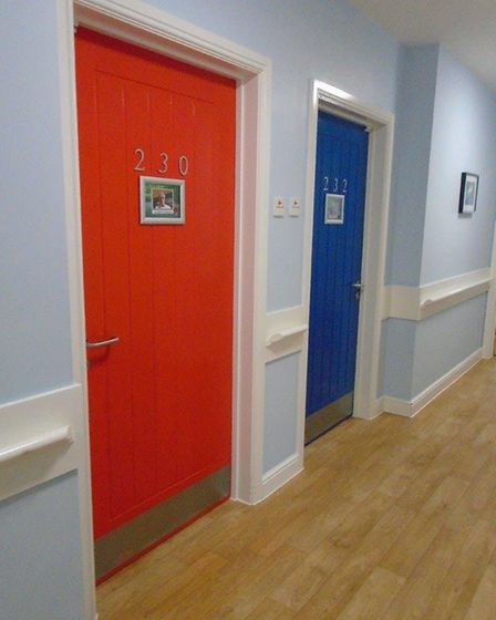Each door in the dementia unit at Howard Lodge care home in Brentwood is painted a different colour