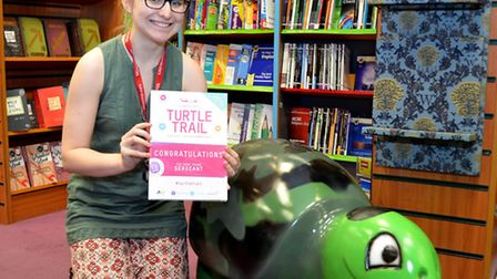 Lowestoft Turtle Trail - Bookseller Victoria Rawlins with the Waterstones turtle