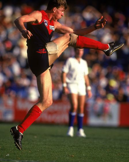 MELBOURNE, AUSTRALIA - 1993: Jim Stynes of the Demons kicks for a goal during the round two AFL mat