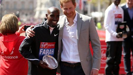 Sir Mo Farah poses for a photo with Prince Harry after finishing third in the 2018 London Marathon (