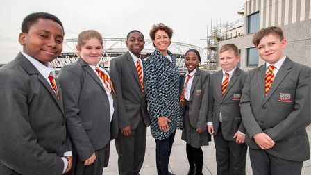 Stephanie Moore with Bobby Moore Academy pupils Gabriel Boateng, Ellamay Gold, Marley Bryden-Campbel