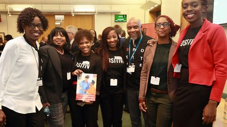 B-Positive Choir members hold a copy of the sickle cell standards at launch event. Picture: Darnell
