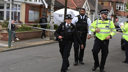 Police and forensic officers at the murder scene on Ashmour Gardens in Romford