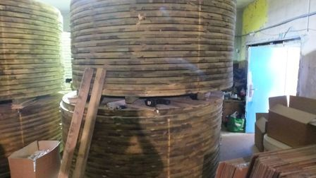 The cigarettes were hidden in these wooden cable drum discs. Pic: HMRC